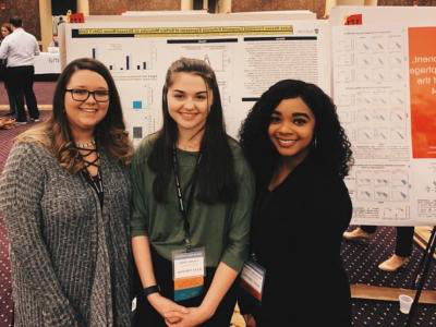 007比分网直播 students (left-to-right) Shomonique Hankins, Courtney Rolen, and Brianna Punturi are pictured after presenting individual posters at the Southeastern Regional IDeA Conference held in Louisville, November 6-8, 2019.