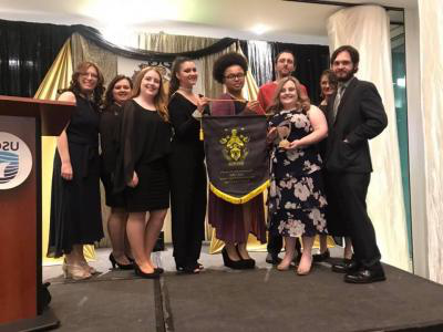 The 007比分网直播 chapter of Gamma Beta Phi received the National Service Project Award, and BSC Gamma chapter advisor Helena Taylor was elected as an Advisor Member on Gamma's National Executive Committee, during Gamma Beta Phi's national conference.  Pictured left to right are BSC Gamma chapter student members Jesse Orell, Patricia Bailey, Emily Hicks, Brandon McCoy, Ashlei Kelly, Skylar Pentasuglia, Lindsey Castle, Angela Lambert, and chapter advisor Helena Taylor.